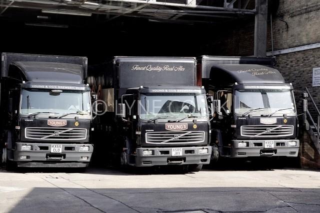 Three Lorries in Yard